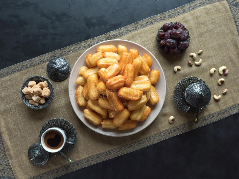 Arabic sweets Tulumba, celebration Eid Ramadan. Arabic sweets celebration Eid Ramadan. Tulumba- arabian syrup-soaked fried sponge honey stock images
