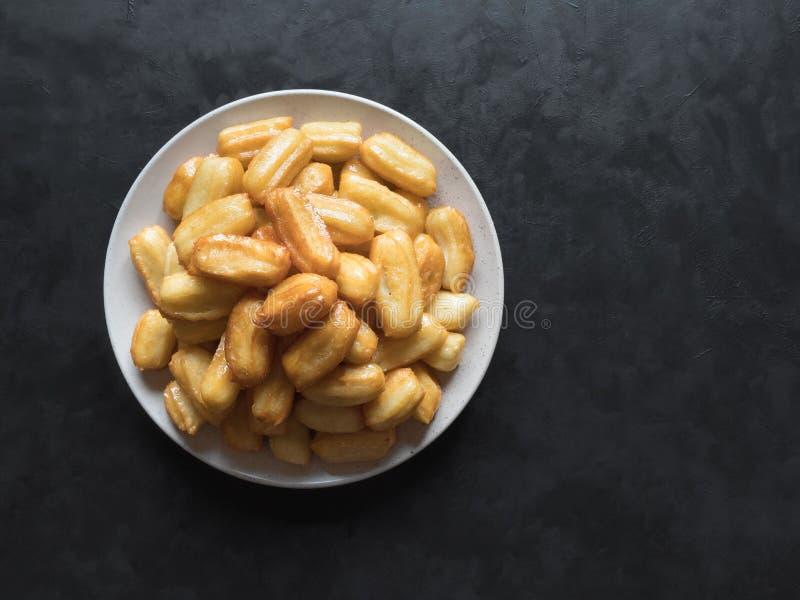 Arabic sweets Tulumba, celebration Eid Ramadan. Arabic sweets celebration Eid Ramadan. Tulumba- arabian syrup-soaked fried sponge honey stock photography