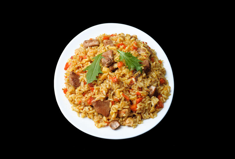 Arabic traditional cuisine - rice pilaf with meat and carrots. T stock photo