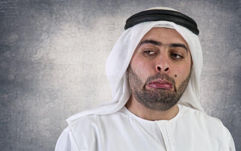 Arabische zakenman met een bizarre uitdrukking royalty-vrije stock foto's