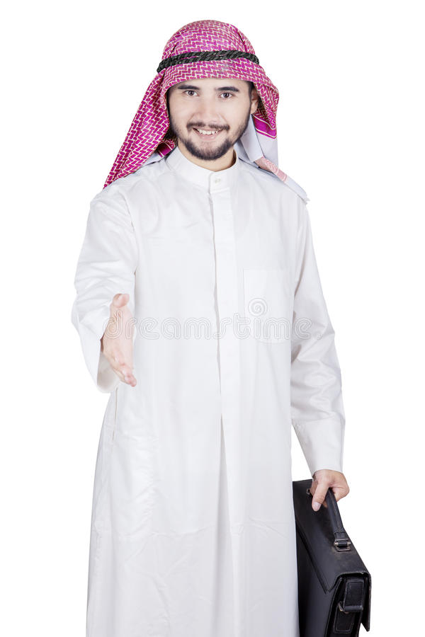 Arabischer Geschäftsmann bietet Händedruck an lizenzfreies stockbild
