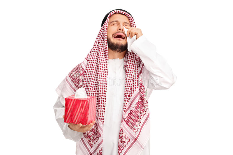 Arabo triste che grida e che pulisce i suoi strappi immagini stock