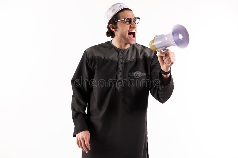 Arabski mężczyzna mówi w megafonie zdjęcia royalty free