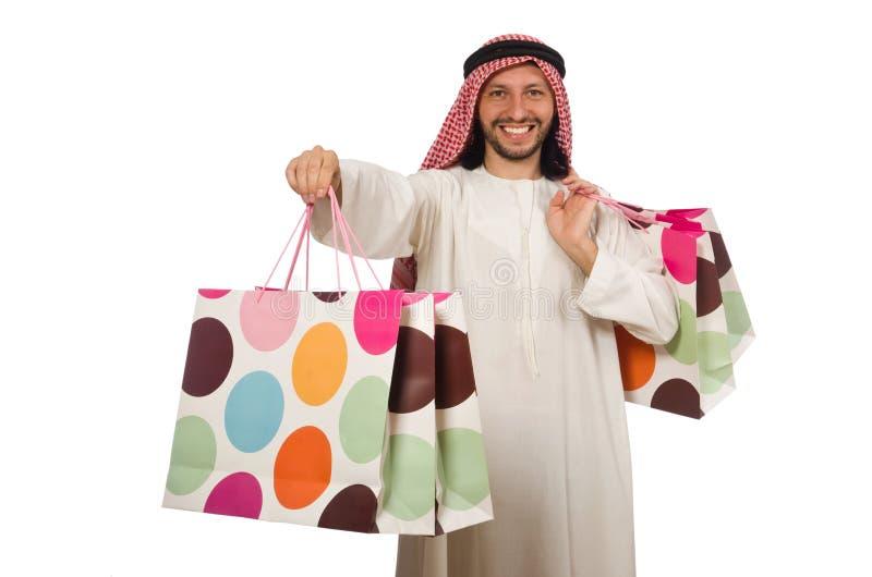 Arabski mężczyzna z torba na zakupy na bielu obraz royalty free