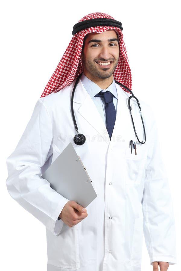 Arabskich saudyjskich emiratów doktorska pozuje trzyma medyczna historia obrazy royalty free