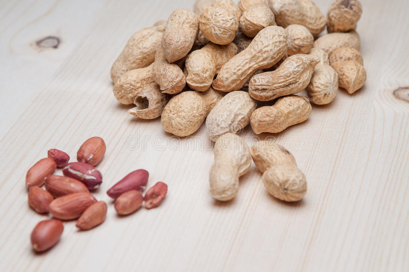 arachidy zgłaszają drewnianego obraz stock
