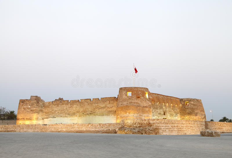 Arad Fort is a 15th century fort in Arad, Bahrain. Arad fort in the evening stock images