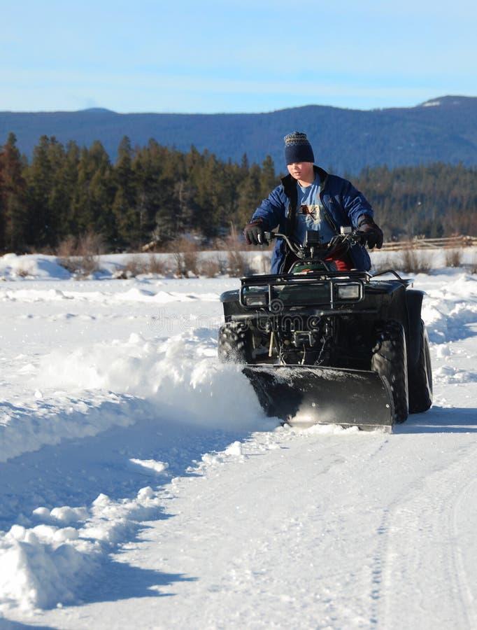 Arado de neve de Atv fotos de stock