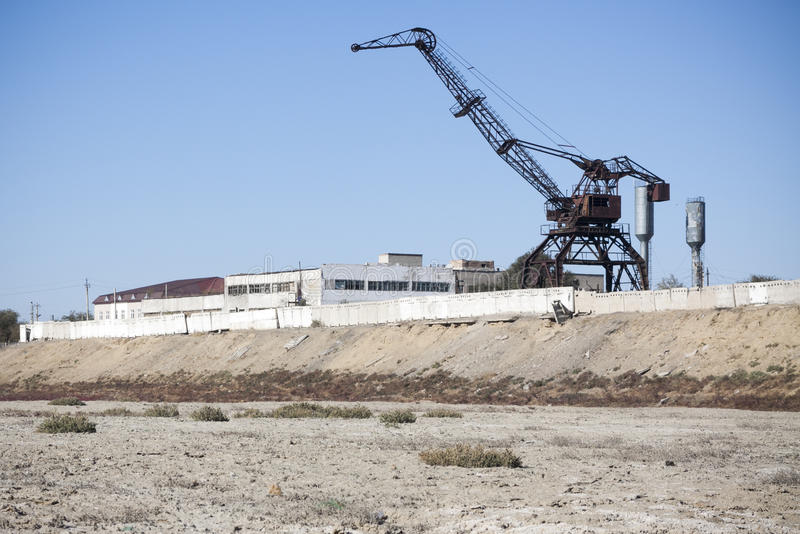 Aral Sea - kazakhstan. Old abandoned cranes in Aral harbour stock photo
