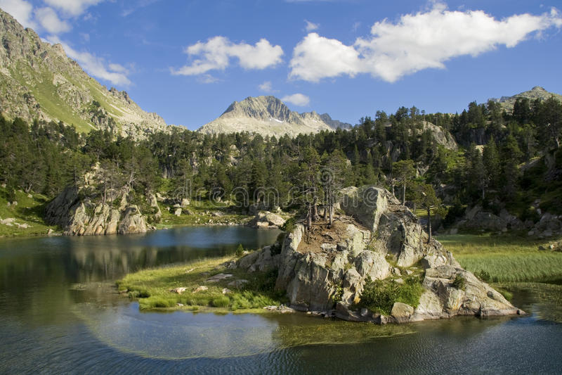 Aran Valley. Lake with a small islet in the Aran Valley, Catalan Pyrenees royalty free stock photo