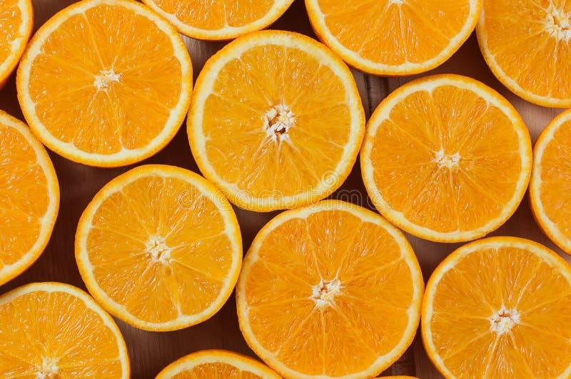 Arance affettate come fondo fotografie stock libere da diritti