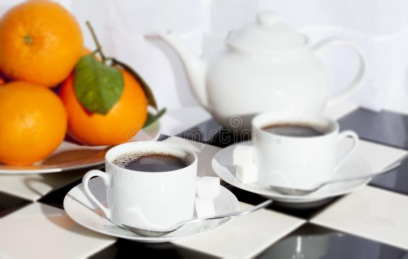 Arance della teiera del tè immagini stock
