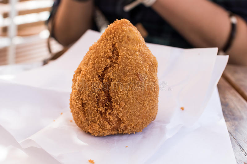 Arancino with ragù Sicilian gastronomic specialty. Fried rice dumplings with meat sauce stock images