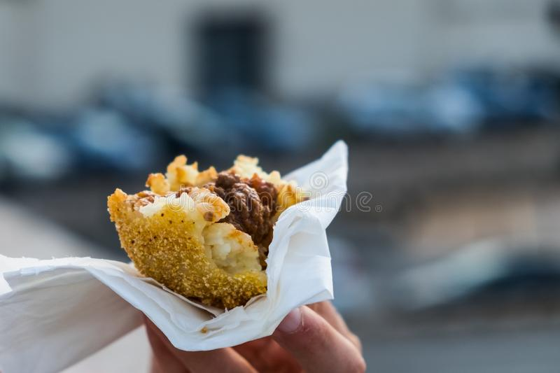 An arancino, the typical sicilian street food stock photography