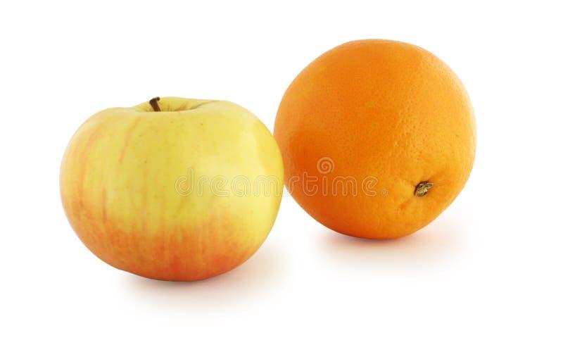 Arancio e mela fotografia stock libera da diritti