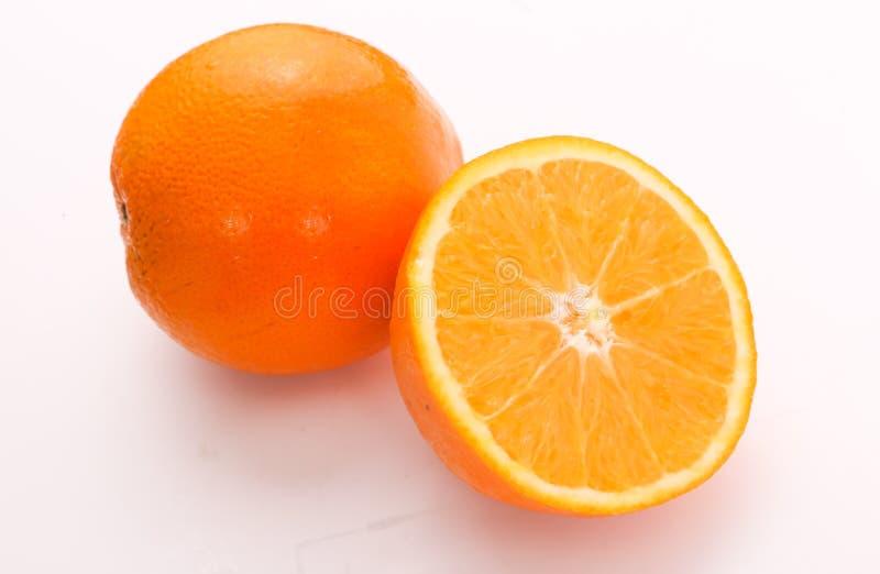 Arancio - a metà arancio immagine stock