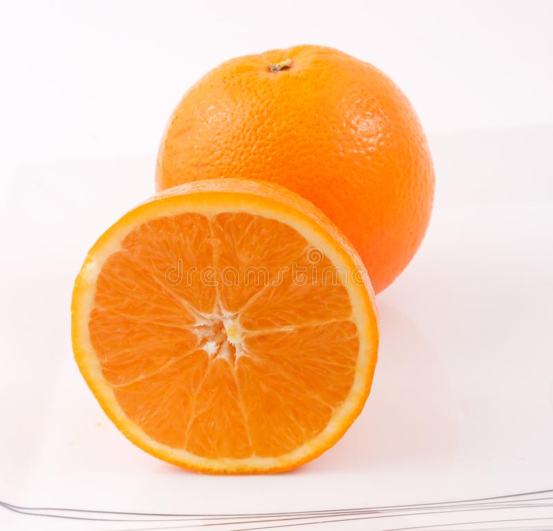 Arancio - a metà arancio fotografie stock libere da diritti