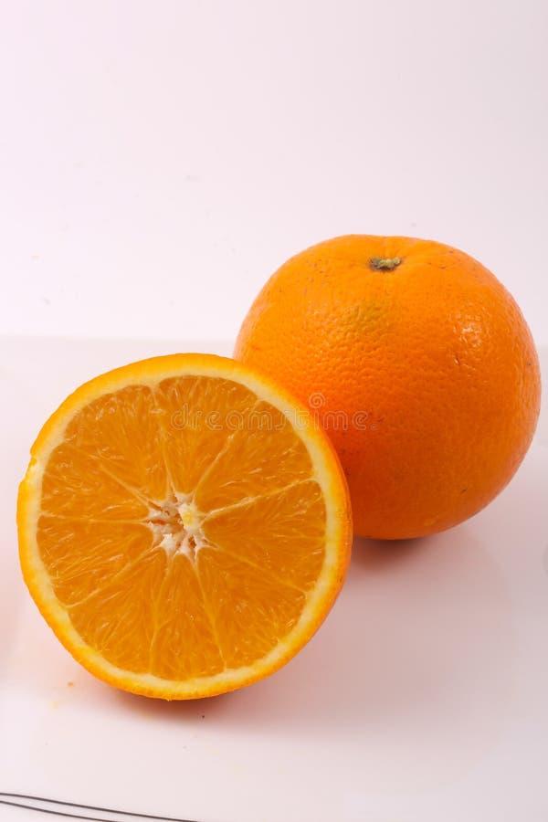 Arancio - a metà arancio immagini stock libere da diritti