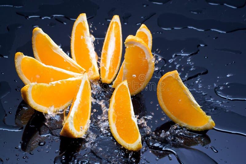 Arancio in spruzzata fotografia stock