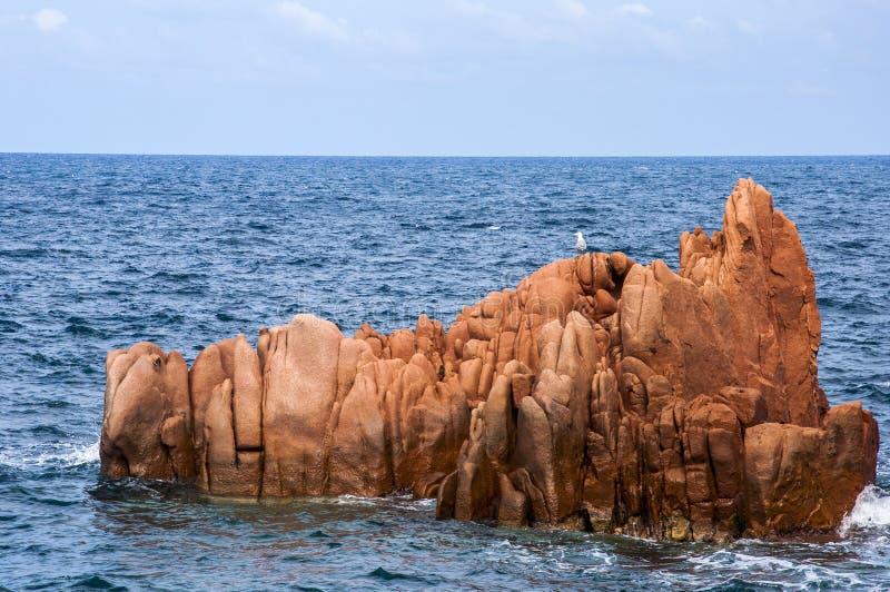 Arbatax red porphyry rocks nearby port Capo Bellavista sardegna Sardinia Italy Europe royalty free stock photo