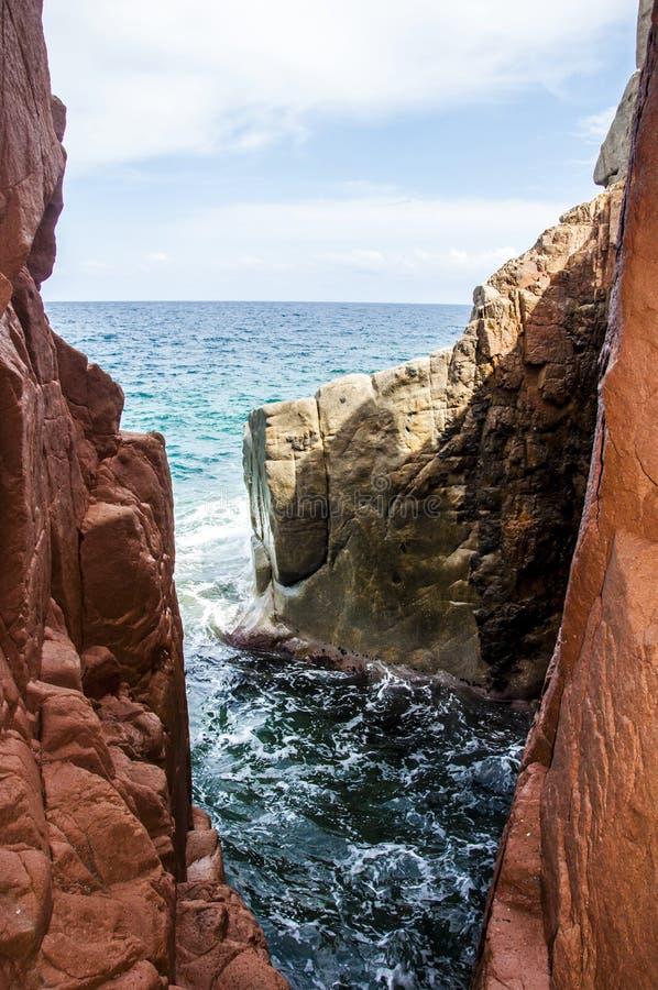 Arbatax red porphyry rocks nearby port Capo Bellavista sardegna Sardinia Italy Europe royalty free stock photos