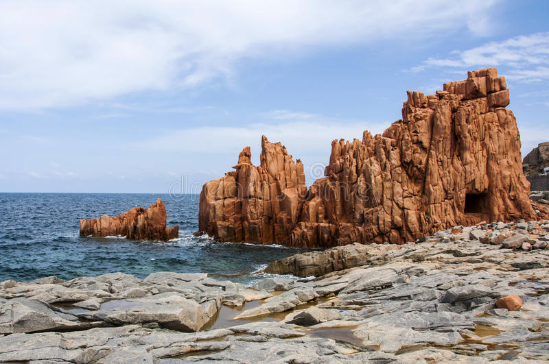 Arbatax red porphyry rocks nearby port Capo Bellavista sardegna Sardinia Italy Europe stock photography