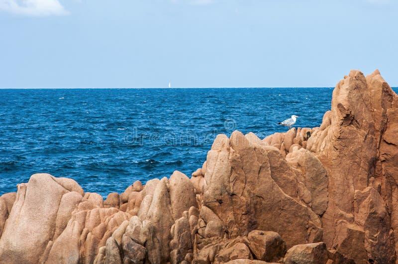Arbatax red porphyry rocks nearby port Capo Bellavista sardegna Sardinia Italy Europe stock photo