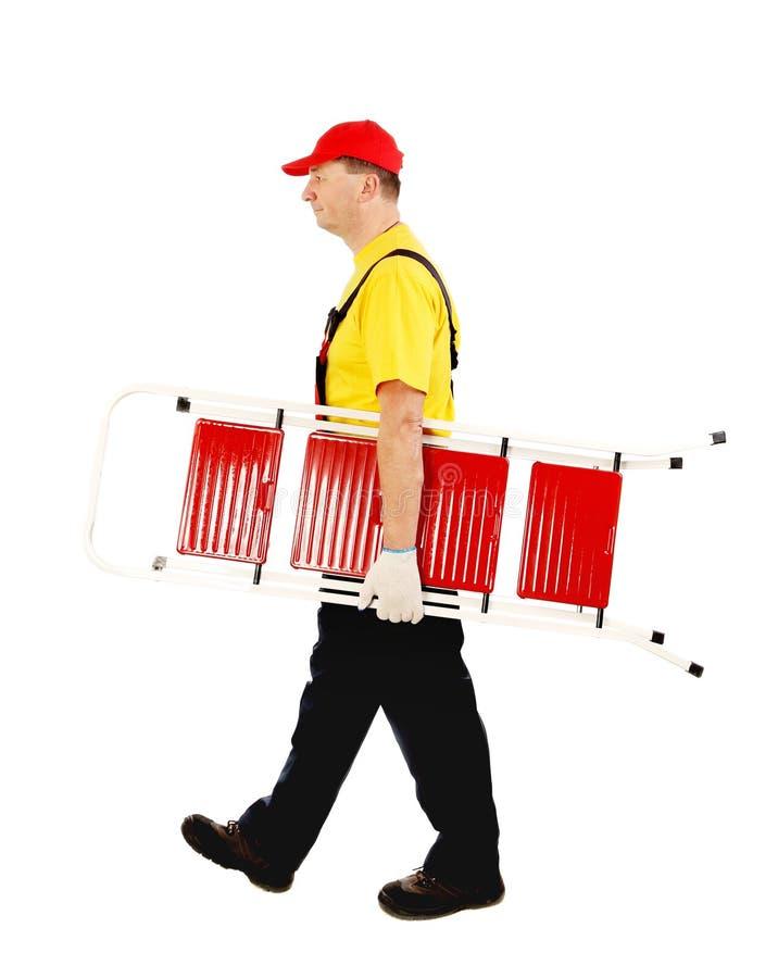 Arbeider die met in hand ladder gaan royalty-vrije stock foto's