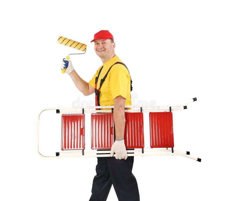 Arbeider met ladder en broodje. royalty-vrije stock afbeelding
