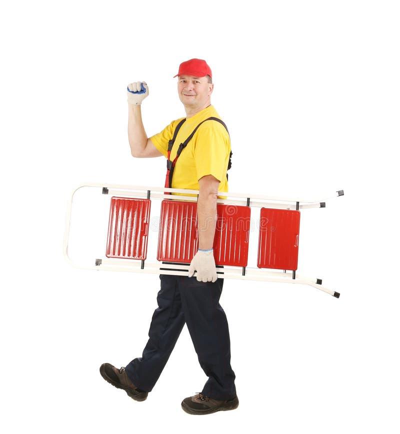Arbeider met ladder het glimlachen. royalty-vrije stock fotografie