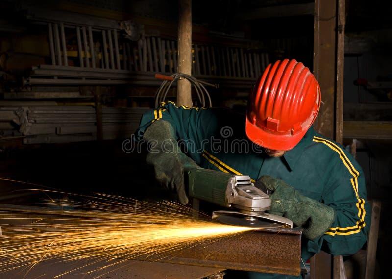 Arbeider met molen stock afbeelding