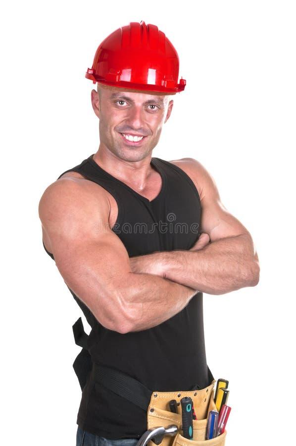 Arbeider met rode helm stock afbeeldingen