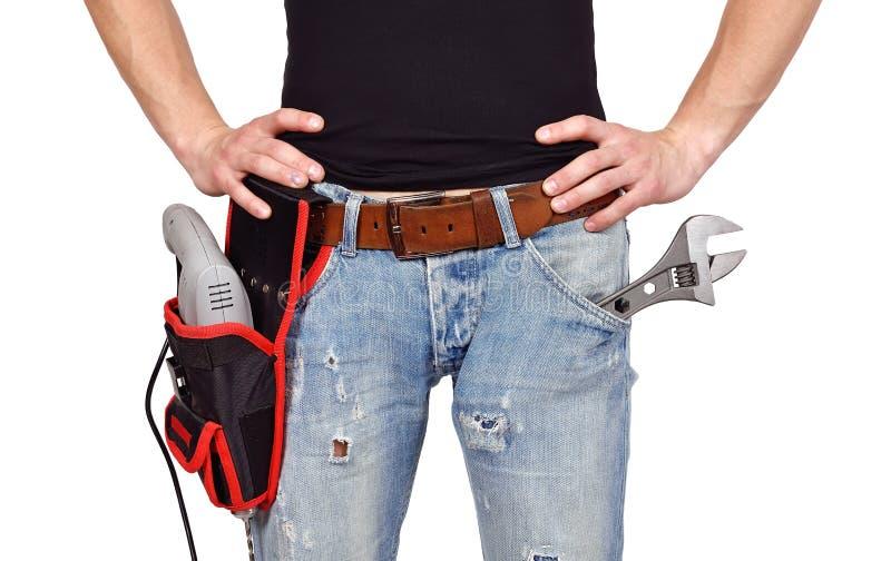 Arbeider met toolbelt stock foto