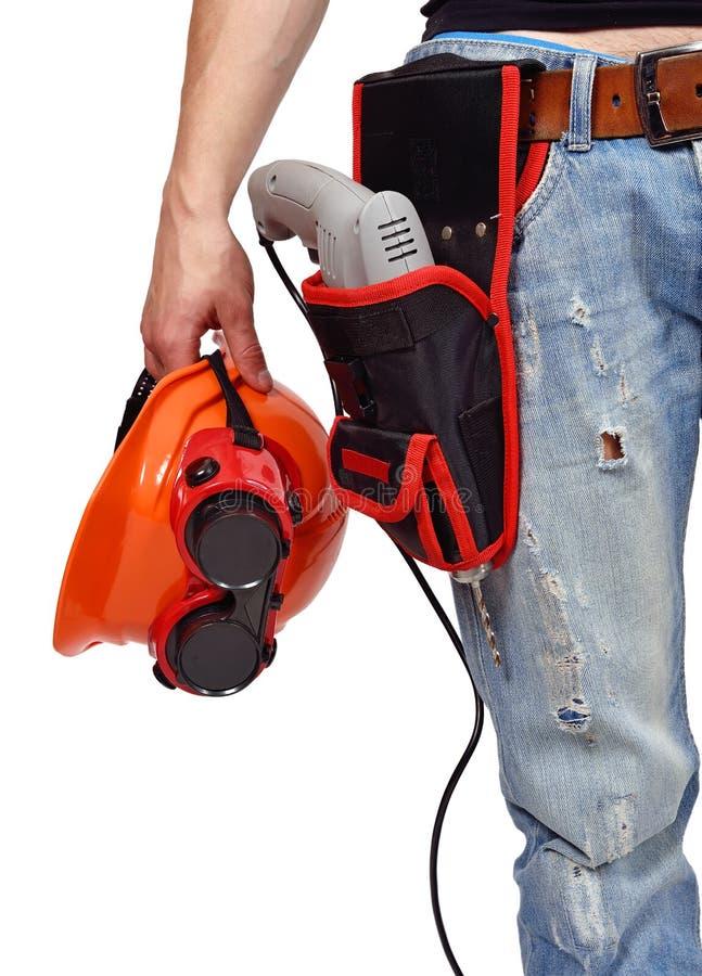 Arbeider met toolbelt en helme stock foto's