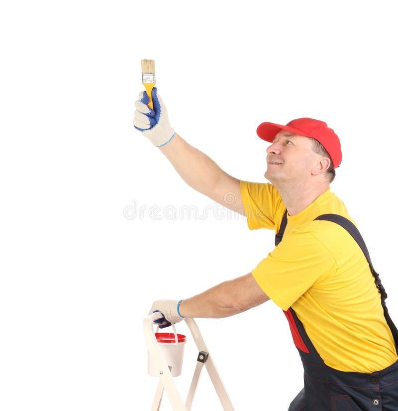Arbeider op ladder met borstel royalty-vrije stock afbeelding