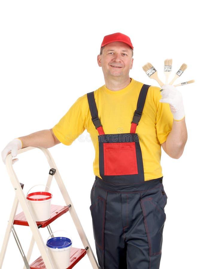 Arbeider op ladder met borstels royalty-vrije stock afbeeldingen