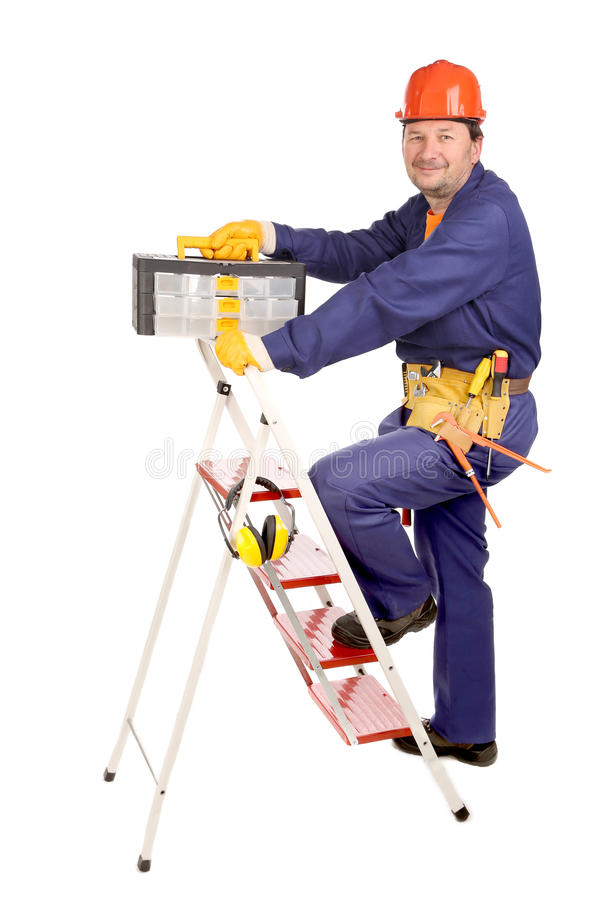 Arbeider op ladder met toolbox royalty-vrije stock foto