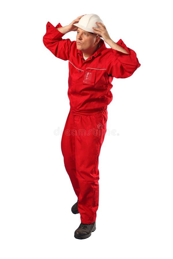 Arbeider in rode eenvormige het dragen witte bouwvakker royalty-vrije stock afbeeldingen