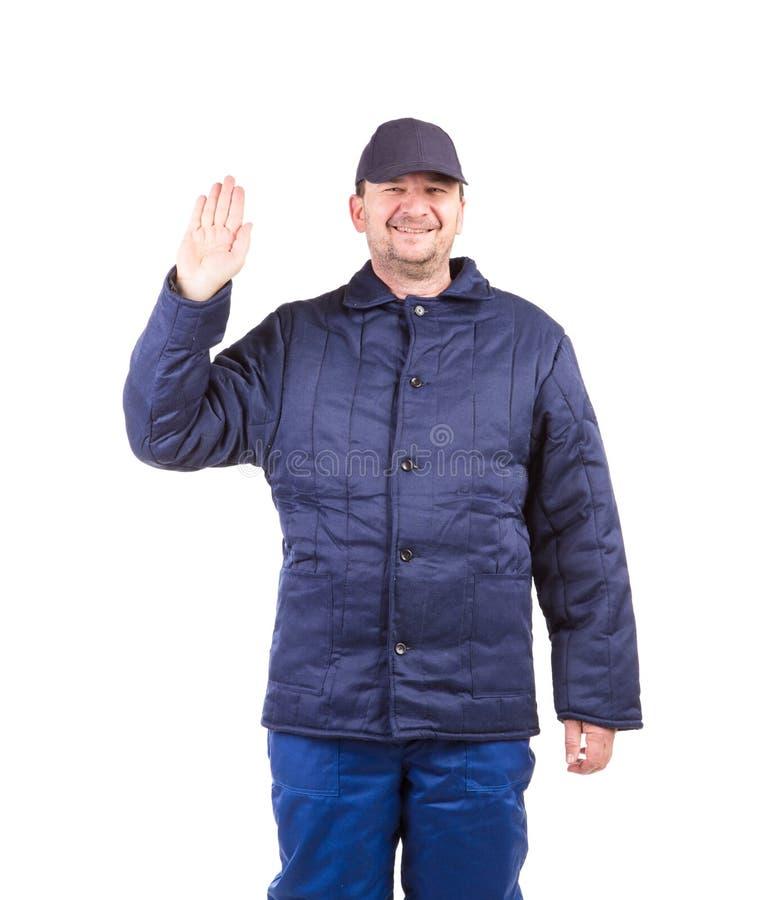 Arbeider in workwear de winter stock foto's