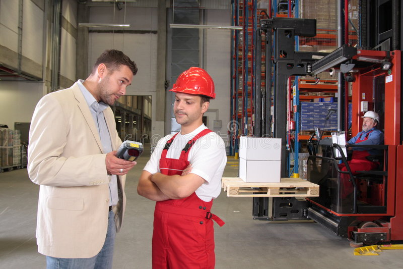Arbeiders & werkgever in fabriek royalty-vrije stock foto's
