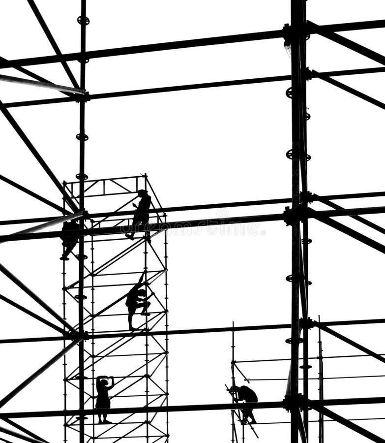 Arbeiders op een Steiger van het Staal stock afbeeldingen
