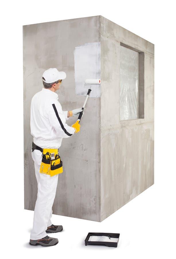 Arbeidersinstructie met een het cementmuur van de verfrol stock fotografie