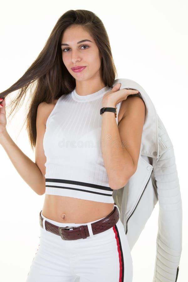 Arbeiten Sie Blickzauber stilvolles schönes Jugendlichmodell der jungen Frau um stockfotos