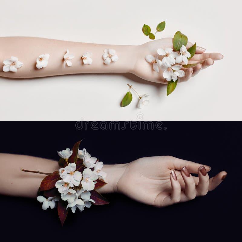 Arbeiten Sie Kunsthandfrau in der Sommerzeit und Blumen auf ihren Handwi um stockbild