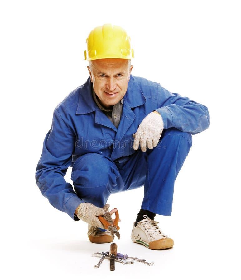 Arbeiter, der auf dem Fußboden sitzt stockfotos