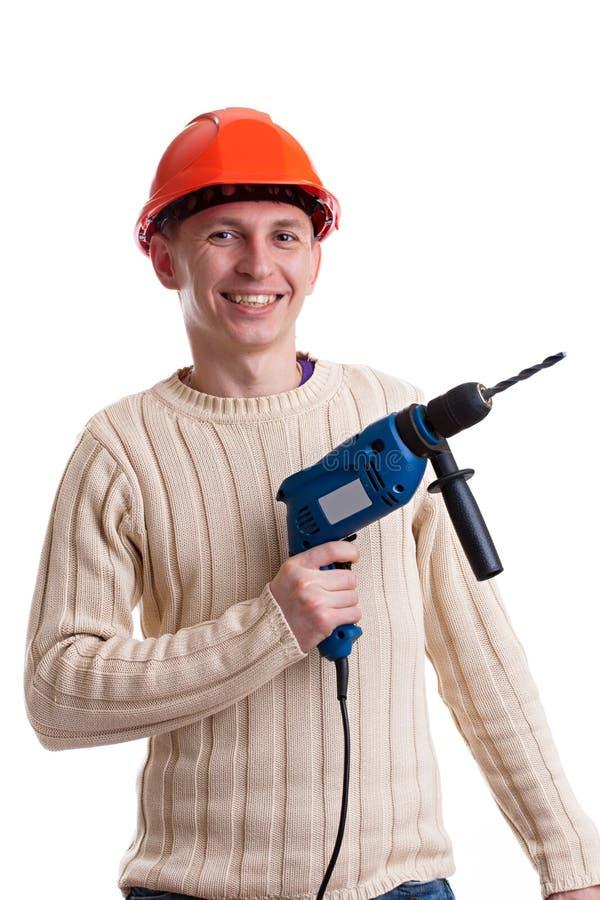 Arbeiter mit Bohrgerät lizenzfreies stockbild