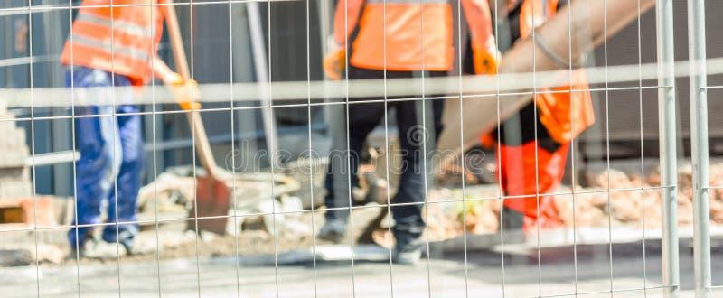 Arbeitskräfte auf einem Straßenbau stockfotografie