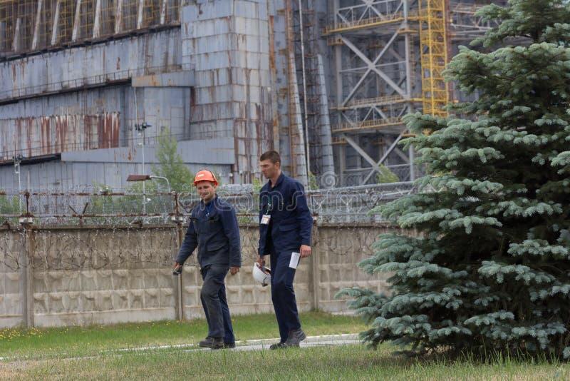 Arbeitskräfte, die Tschornobyl Atomkraftwerk, Reaktor #4 verlassen lizenzfreie stockfotos