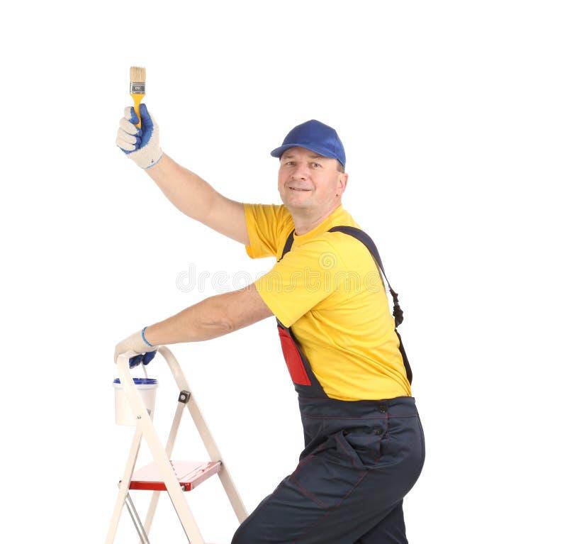 Arbeitskraft auf Leiter mit Bürste lizenzfreie stockfotografie