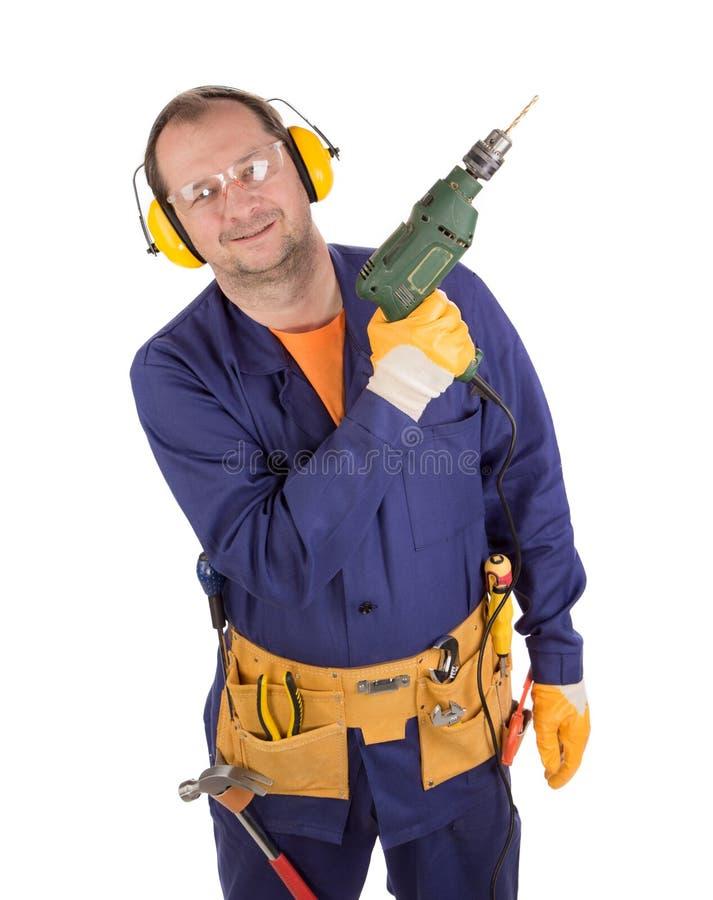 Arbeitskraft auf Leiter mit Bohrgerät lizenzfreies stockbild
